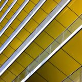 Complex building structural detail, yellow metal b Stock Photos