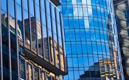 Multiple Reflections in Modern Building Glazed Facade, Sydney, Australia. Complex deconstructed multiple facet reflections in glass glazed building facades on royalty free stock image