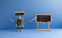 Complex fractions math lesson. Mathematician robot teacher with pointer explains handwritten example exercise on black. Chalkboard. Blue interior classroom stock photography
