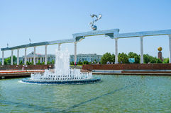 The complex of Independence Square. TASHKENT, UZBEKISTAN - MAY 7, 2015: The Arch of good and noble aspirations with the beautiful fountain on the foreground, on royalty free stock photos
