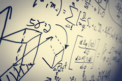 Complex math formulas on whiteboard. Mathematics and science with economics Royalty Free Stock Image