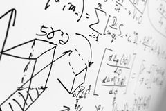 Complex math formulas on whiteboard. Mathematics and science with economics Royalty Free Stock Photos