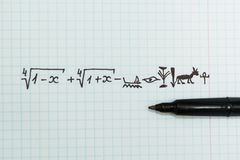 Complex mathematical examples in the notebook as Egyptian hieroglyphs royalty free stock photos