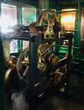 A complex mechanical system in Kunoor Lighthouse Museum. A complex mechanical system consisting of gears, pinions, shafts, cams etc. of a modern lighthouse Stock Photography