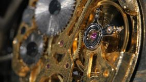 Complex movement old mechanism. Close up. Gears mechanical clock, gear system rotation, clock gear, mechanical clock gear, close up stock video footage