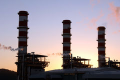 Complex of oil refinery. Industrial complex of oil refinery factory at sunset royalty free stock photo