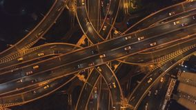 Complex Road Junction at Night. Shanghai City. China. Aerial Vertical Top-Down View