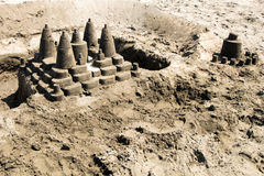 Complex sandy castle on the beach stock photography