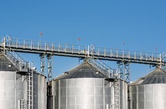 The complex silo installations for the storage of grain standing in the plowed Stock Photo