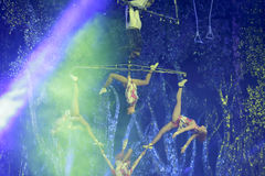 Complex swing acrobatic under spotlight Royalty Free Stock Photography