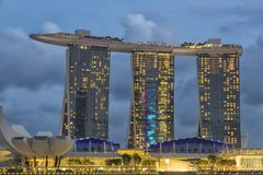 Marina Bay Sands famous landmark in Singapore. The complex is topped by a 340-metre-long  SkyPark with a capacity of 3,900 people and a 150 m  infinity swimming Stock Images