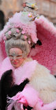Complex Venetian disguise. Venice,Italy - February 25th, 2011: Portrait of a woman with a eye mask and a very sophisticated hairdo in Venice during The Carnival royalty free stock photo