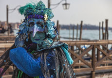 Complex Venetian Disguise. Venice, Italy- February 18, 2012: A person wearing a complex and interesting Venetian disguise during the Carnival days royalty free stock photo