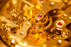 Complex watch movement close-up. A beautiful vintage watch movement in warm light Stock Photography