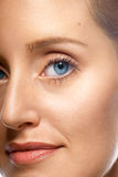 Complexion. Close-up of beautiful woman's face showing clean complexion stock photography