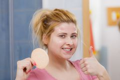 Woman having wash gel on face holding sponge. Complexion, skincare products concept. Woman having wash gel on face holding sponge about to clean her skin showing Stock Photography