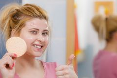 Woman having wash gel on face holding sponge. Complexion, skincare products concept. Woman having wash gel on face holding sponge about to clean her skin showing Stock Photos