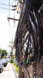 The complexity of the cable wire on street of Samui, Thailand. This is the complexity of cable wire. it is so dangerous for tourist to walk pass by Royalty Free Stock Photo