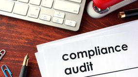 Compliance audit. Compliance audit on a document and other papers Royalty Free Stock Photo