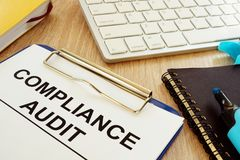 Compliance audit and documents. Compliance audit and documents on a desk stock image