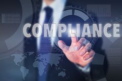 Compliance concept. Business man with touch screen, international regulations stock photo