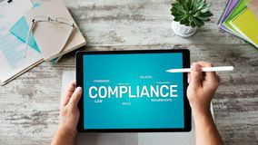 Compliance concept with icons and diagrams. Regulations, law, standards, requirements, audit. Concept on device screen. Compliance concept with icons and royalty free stock image
