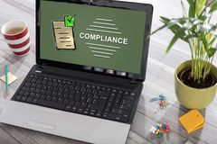 Compliance concept on a laptop. Laptop on a desk with compliance concept on the screen stock photo