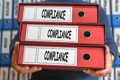 Compliance concept words. Folder concept. Ring binders. Royalty Free Stock Image
