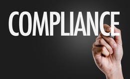 Compliance on a conceptual image stock photos