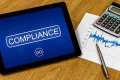 Compliance on digital tablet Stock Images