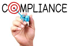 Compliance. Drawing 'Compliance Target' Concept on transparent white board with blue marker stock images