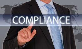 Compliance - Manager with touchscreen stock photo