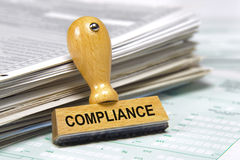 Compliance. Marked on rubber stamp in office with documents royalty free stock photo