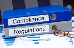 Compliance and regulations binders Stock Photos