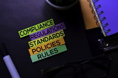 Free Compliance, Regulations, Strandards, Policies, Rules Text On Sticky Notes Isolated On Black Desk. Mechanism Strategy Concept Royalty Free Stock Photos - 155541388