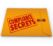 Compliance Secrets Advice Following Rules Yellow Envelope. Compliance Secrets words on a yellow envelope to illustrate advice, tips and information on following Stock Image