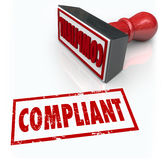Compliance Stamp Word Audit Rating Feedback. Compliance word in rubber stamp of approval as a result of your audit, assessment or evaluation on how your company Stock Image