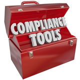 Compliance Tools Toolbox Skills Knowledge Following Rules Laws. Compliance Tools words in red metal toolbox to illustrate important skills, knowledge, tips Royalty Free Stock Photo