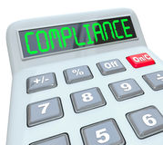 Compliance Word Calcualtor Accounting Financial Audit. Compliance word on calculator display to illustrate results of a financial or accounting audit that Royalty Free Stock Photos