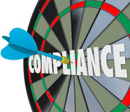 Compliance Word Dart Board Direct Hit Follow Rules Laws Guidelines. Compliance dart hits a board on the word to illustrate following and complying with laws stock illustration