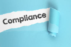 Compliance. Word on torn page Royalty Free Stock Images
