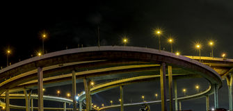 Complicate expressway night time cloudy and electricity post yellow light Stock Image