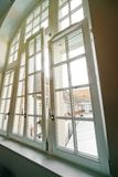 Complicated high windows, new pvc double-glazing while renovation. Sunlight stock photography