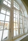 Complicated high windows, new pvc double-glazing while renovation. Sunlight stock photo