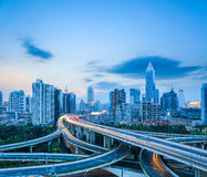 Complicated highway intersection at dusk. Complicated highway intersection with modern city skyline at dusk in shanghai , road transportation infrastructure royalty free stock photo