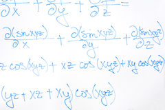 Complicated mathematical equation. Closeup of complicated mathematical equation written with blue marker on white board royalty free stock images