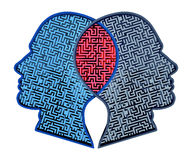 Complicated Relationship. As a concept for group therapy or marriage counseling as two human heads made from a maze merging together in an overlap as an icon of Royalty Free Stock Photos