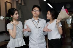 Complicated relationship between three people. Love triangle concept. Complicated relationship between three Asian people. Love triangle concept Royalty Free Stock Photo