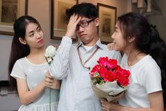 Complicated relationship between three people. Love triangle concept. Complicated relationship between three Asian people. Love triangle concept Stock Images