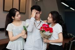 Complicated relationship between three people. Love triangle concept. Complicated relationship between three Asian people. Love triangle concept Royalty Free Stock Photography